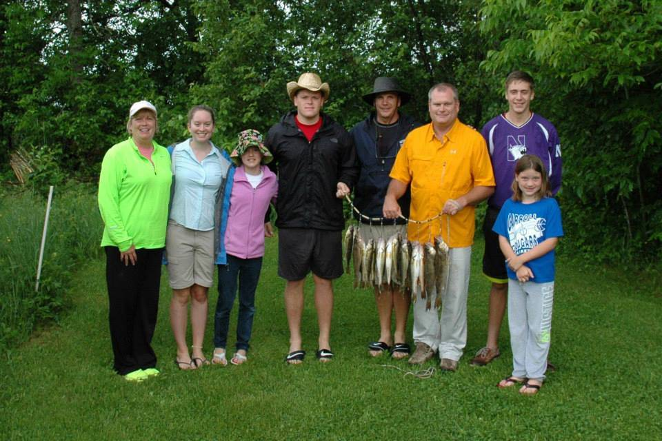 family with stringer of fish at Everett Bay Lodge on Lake Vermilion