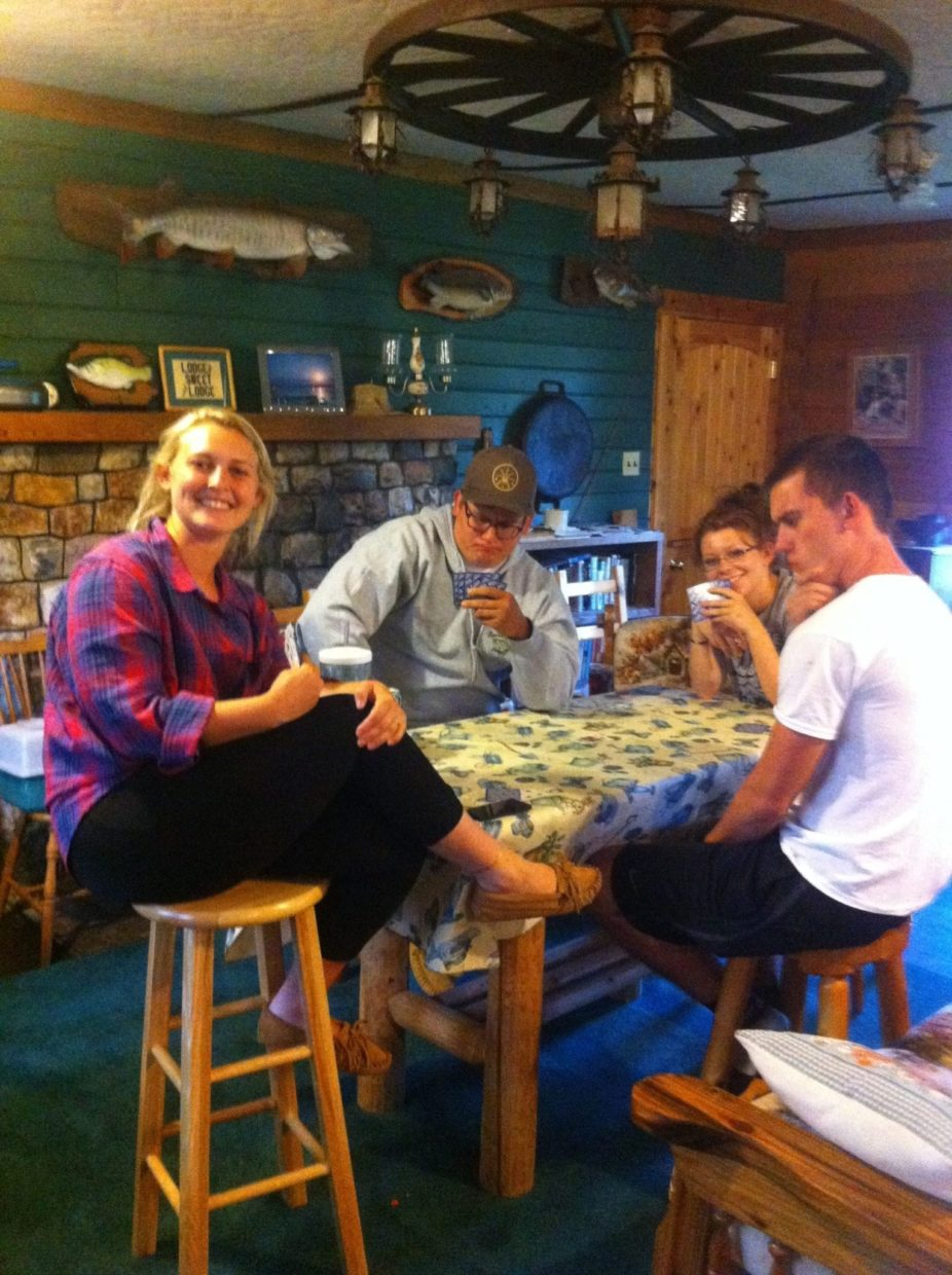 Kids playing euchre in the lodge