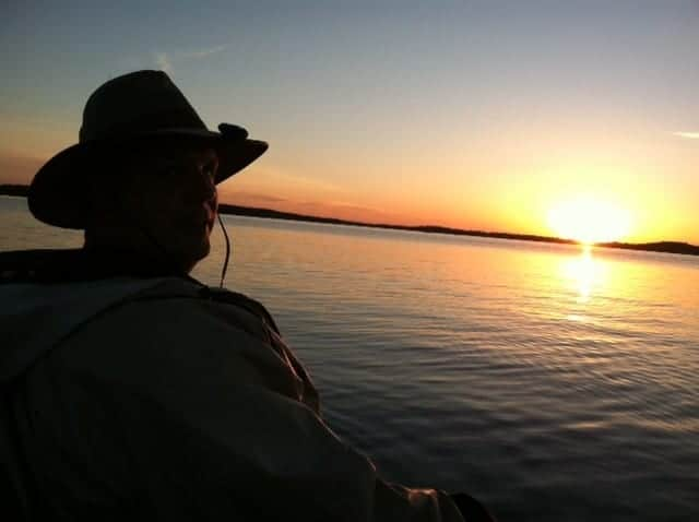 man with sunset on Lake Vermilion