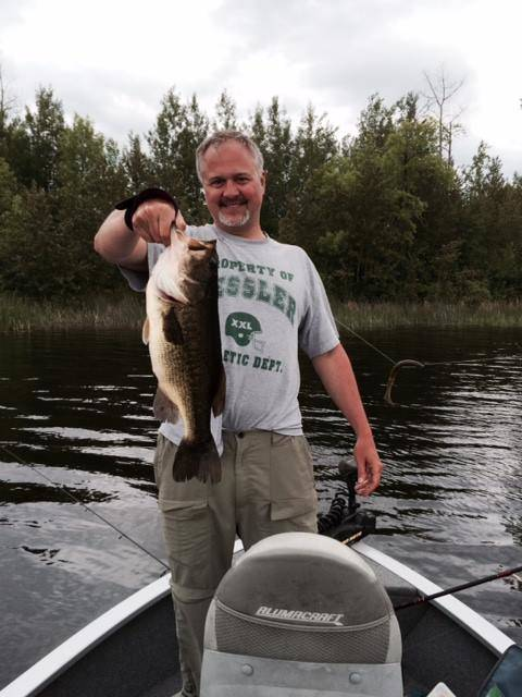 Man holding big largemouth bass on Lake Vermilion