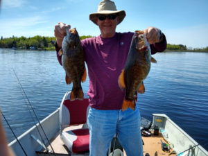 Man with 2 smallmouth bass