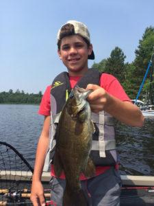 Boy holding smallmouth bass