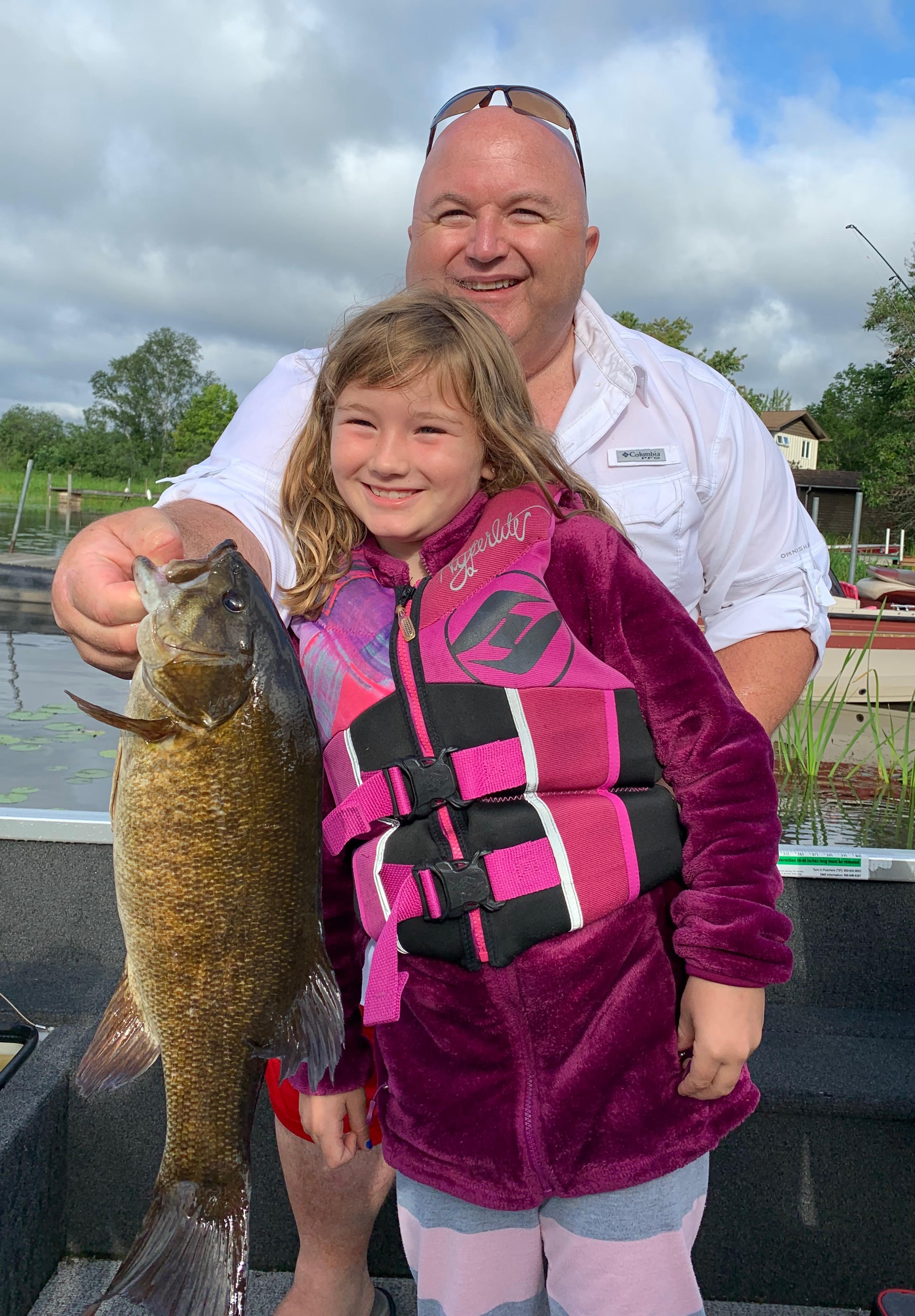 Girl and dad with bass